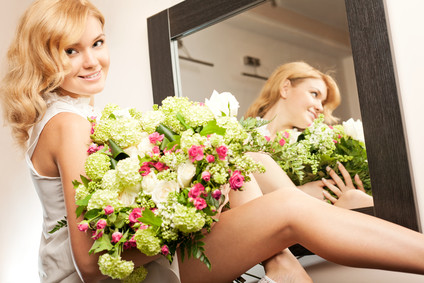 Young beautiful blonde woman with bunch of flowers