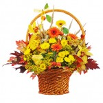 Colorful flower bouquet arrangement centerpiece in wicker basket