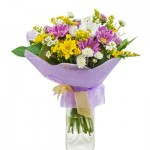 Colorful bouquet from gerberas in glass vase isolated on white b